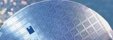 Blue silicon wafer produced in the semiconductor electronics industry